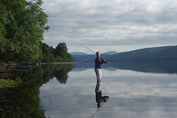 Fisherman standing in Coniston Water