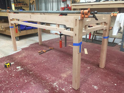 Clamping down a table design