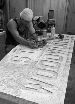 Carving the Stix's Woodworks sign