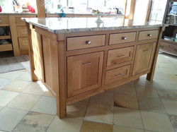Cherry kitchen island with marble