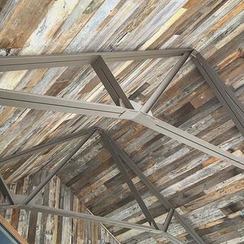 A fresh set of steel trusses to tie this interior together quite nicely!_#elitemetalworks #steelframed #avl #asheville #wnc #interiordesign_