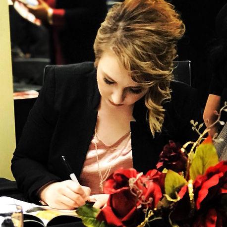 Brandi signing.jpg
