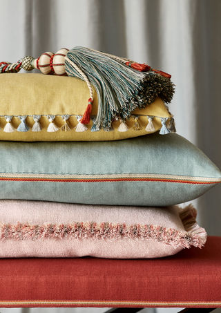 Colefax & Fowler          Cushions trimmed with a variety of braids, fringes and tassels never fail to delight