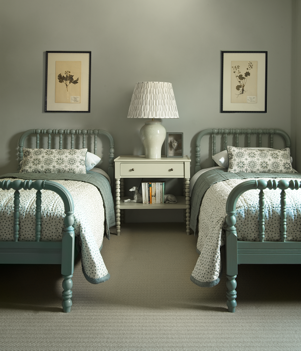 Chelsea Textiles.         The tonal balance is enhanced by the use of strong shadows. The gorgeous carved bed frames add to the sense of comfort and familiarity