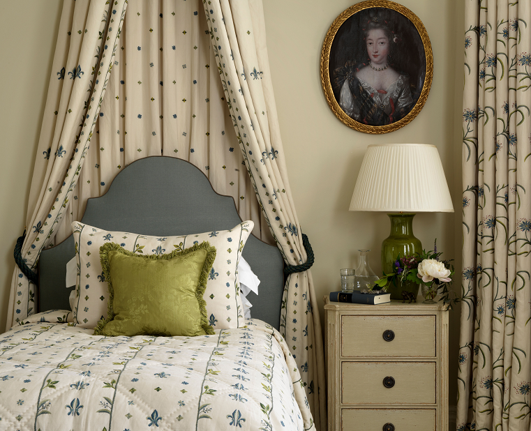 Chelsea Textiles.        The bed drapes give a sense of drama, the colours are gentle and subdued, except for the vibrant green creating a focal point