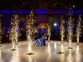"""indoor """"fountains"""" surrounding dancing couple"""
