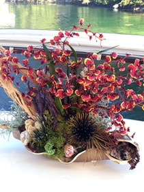 Custom wood and orchid arrangement for yacht