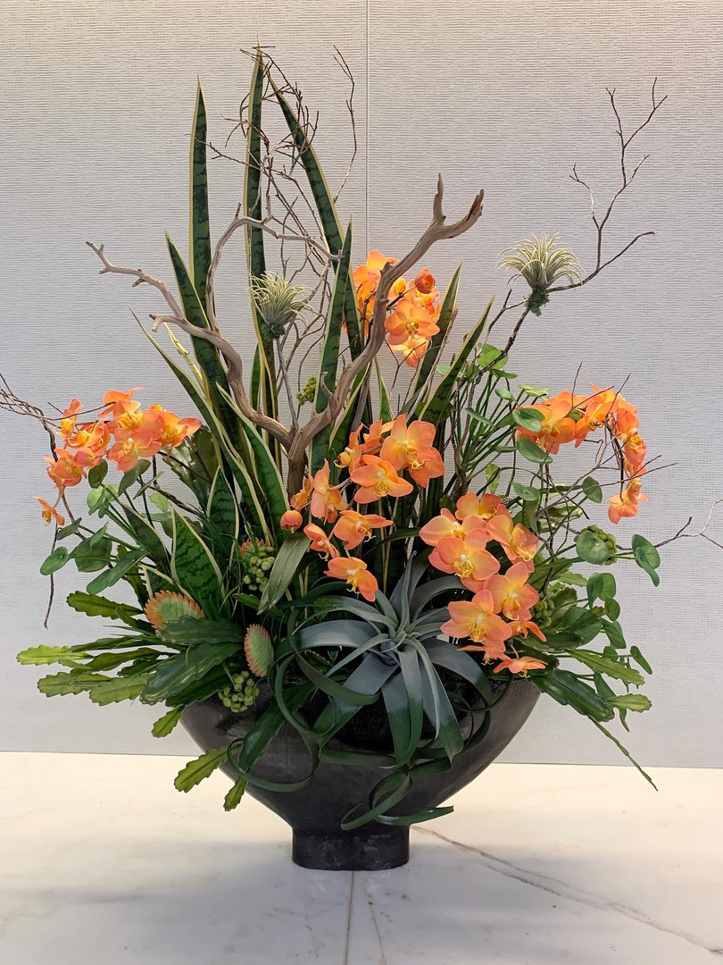 Custom Floral with Orchids, Succulents, wood for Corporate Space