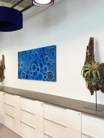 Mirrored complementary wooden scultpures with artificial succulents