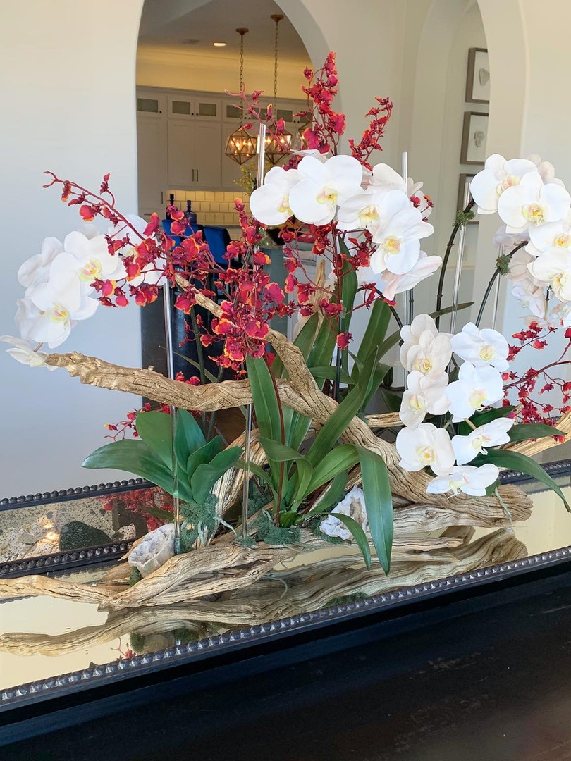 Mixed orchid arrangement on natural wood with geodes