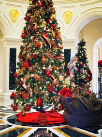 Fully decorated 12' Christmas trees and accessories