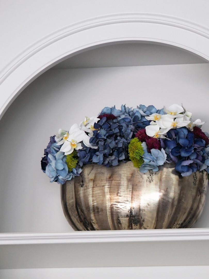 Mixed faux hydrangea and orchid arrangement for client's shelves