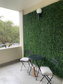 Faux Boxwood custom wall installed on client's highrise