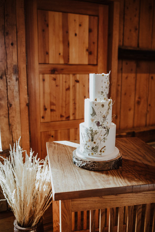 White pressed flower wedding cake