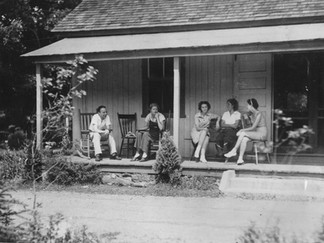Cave Hill Lounging on DR Porch 1940s.jpg