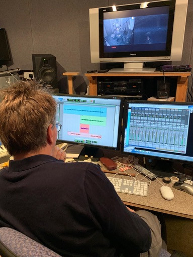 Stephen Chadwick, sound engineering Playsongs Grand Day Out session musicians at work.