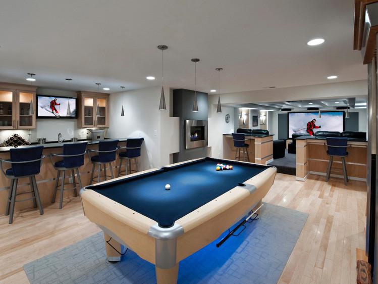 pool table room with wood flooring