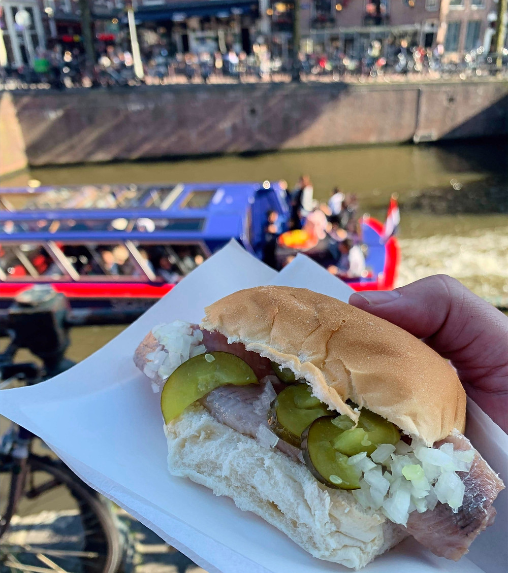 Sandwich with hering, pickles and onions