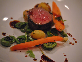 Seared NY Strip with Spring Vegetables and Truffle Jus