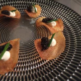 Potato Chip with Caviar and Creme Fraiche