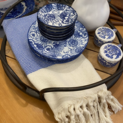 Blue and White Turkish Towel and Plates