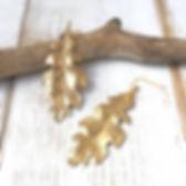 Brass Oak Leaf Earrings wood.jpg