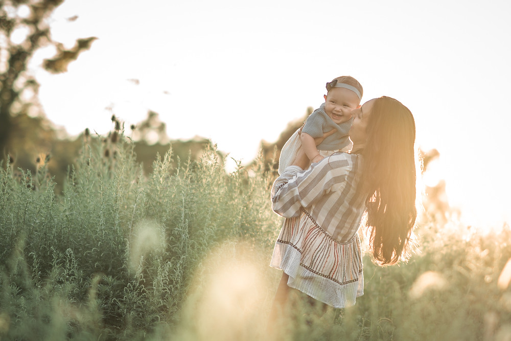 Mother holds daughter at photography shoot in Phoenixville, Pennsylvania