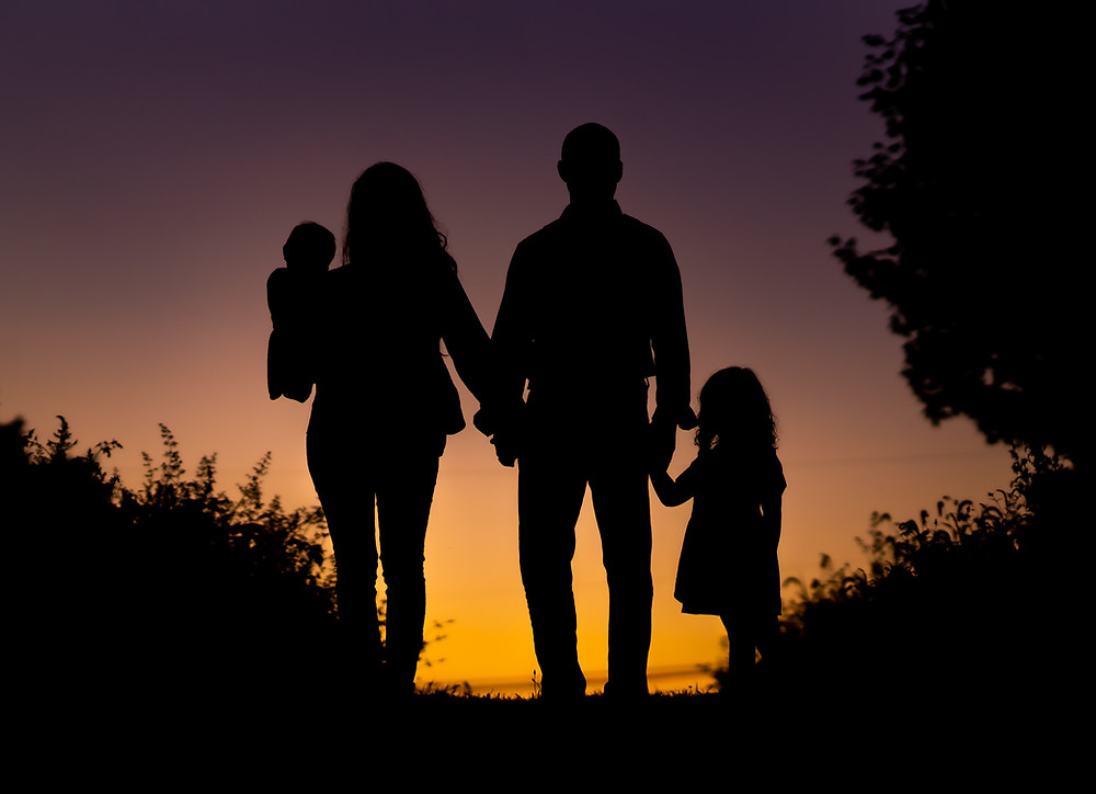 silhouette of a family in a sunset in Phoenixville, PA