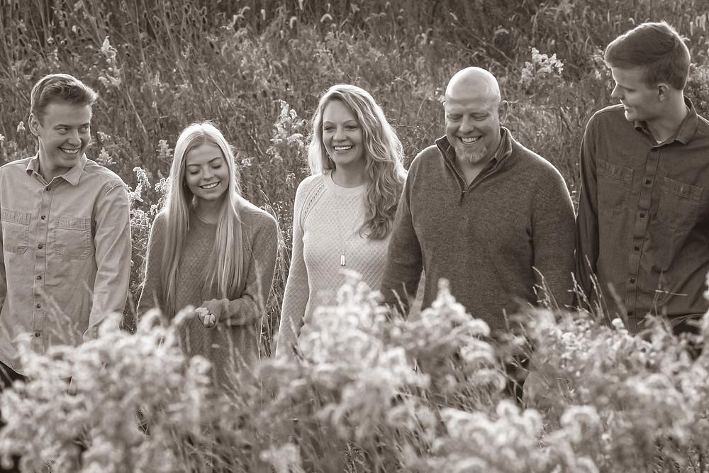 Family walking in a field in Phoenixville