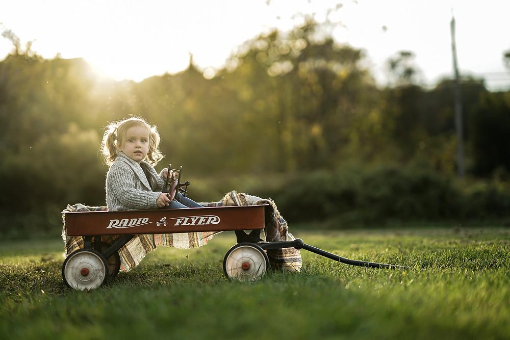 Little girl at sunset at park