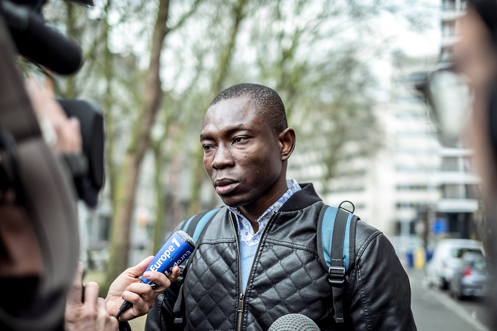 Still shocked by what just happened, this survivor from the Maalbeek attack is being interviewed by different medias near the location of the tragedy.  (c) Aurélien Ernst