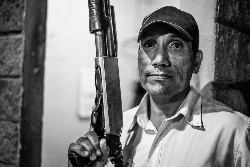 Mario Alberto is a veteran from the civil war of El Salvador. He was fighting for the military-led government of El Salvador against the Farabundo Martí National Liberation Front (FMLN). After being shot in the leg during the conflict, he never entirely recovered from his injury and had to leave the army. He is now ensuring the security of a hotel in San Miguel, El Salvador.