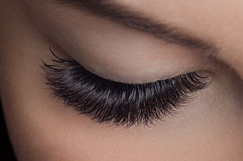 Woman with long lashes in beauty salon.