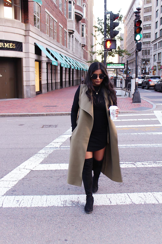 black dress and olive vest