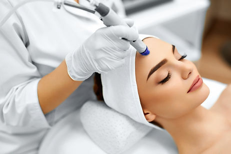 Face Skin Care. Close-up Of Woman Getting Facial Hydro Microdermabrasion Peeling Treatment