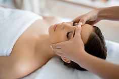 Calm girl having spa facial massage in l