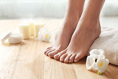 Woman with beautiful feet, towel and flo