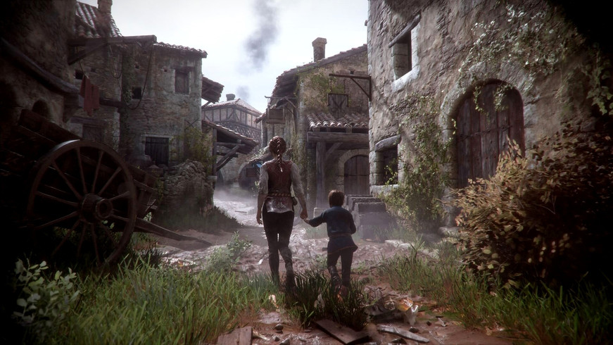 Amicia and Hugo De Rune from the game A Plague Tale: Innocence walking through the alleys of a small town in the game.