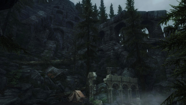 A mountain-side full of mysterious stone structures with a small tent from a camp at the very bottom. Image from the game Enderal: Forgotten Stories