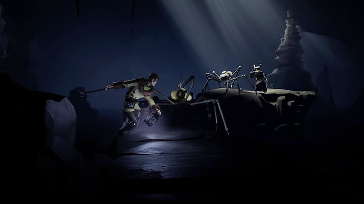 The controllable character of the game Ashen fighting two spider-like creatures in a dark cave with some rays of light coming off from the top of the image