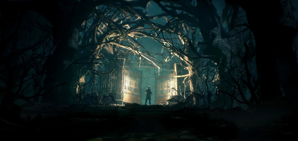 A man standing at night in a dark, scary forest holding a lantern at the front of a tall iron gate