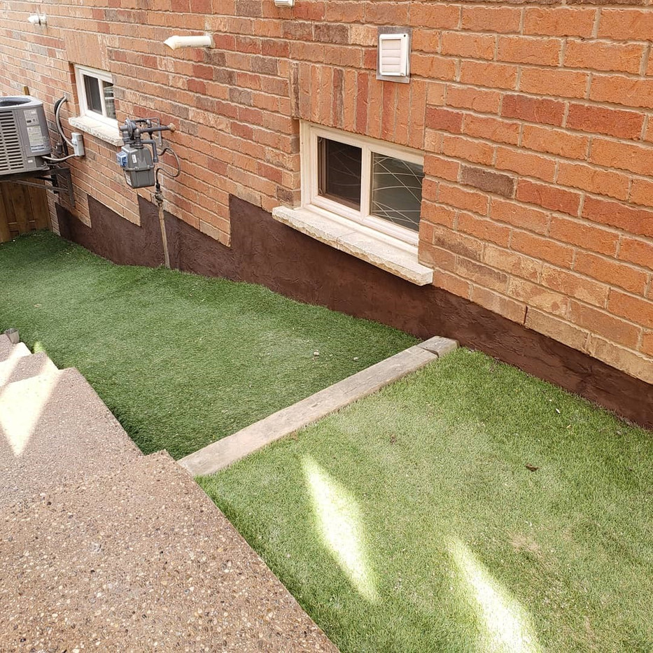 Exposed aggregate steps and Jewelstone foundation wall parging