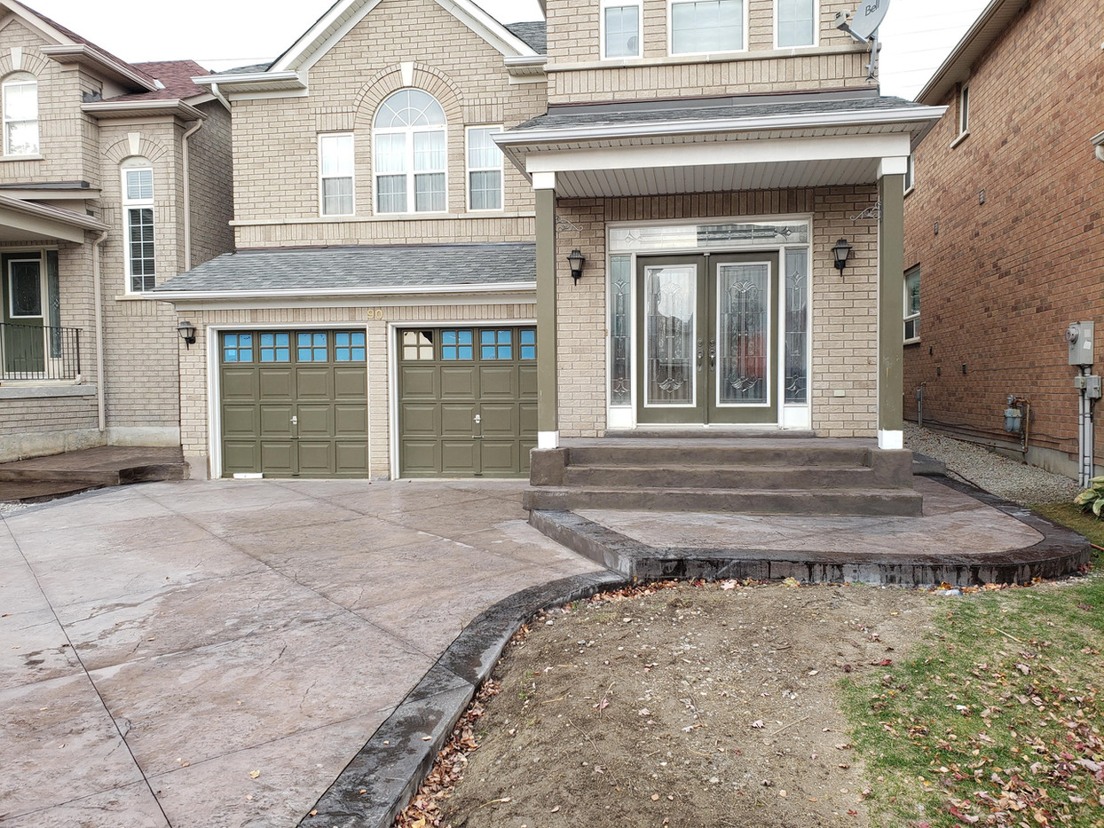 New stamped concrete driveway and steps with acid stained border