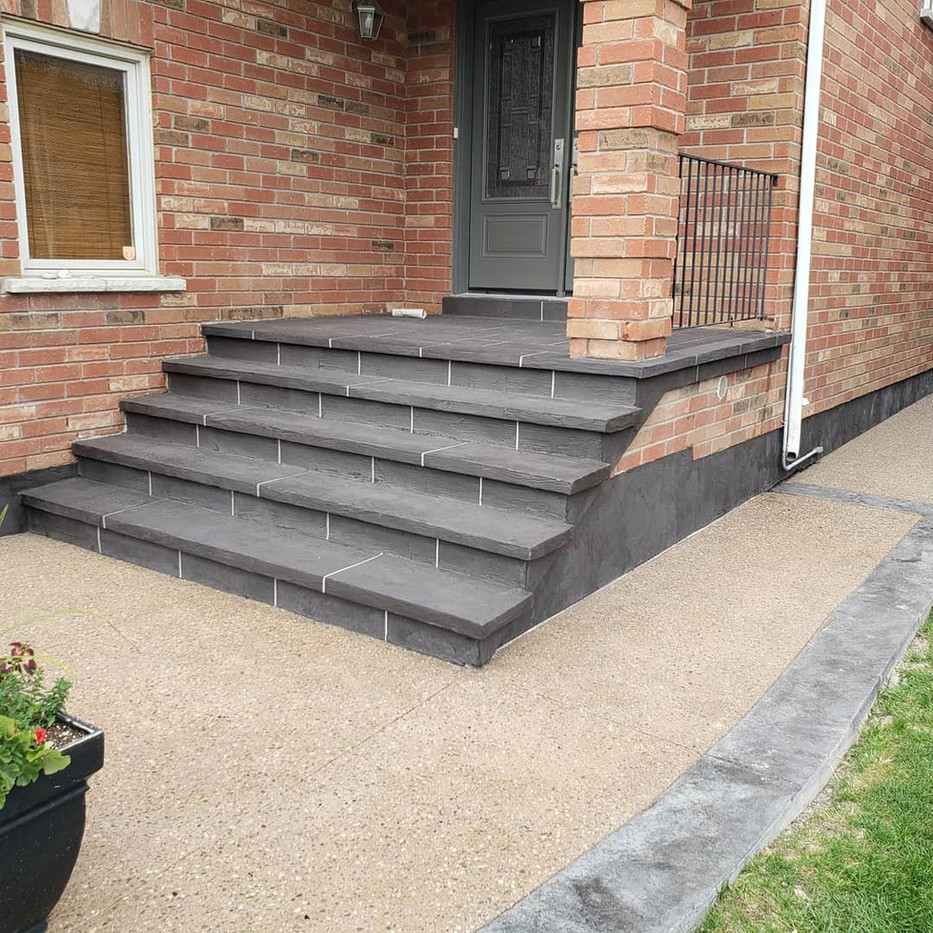 Exposed aggregate with stamped concrete border. Steps finished with Jewelstone