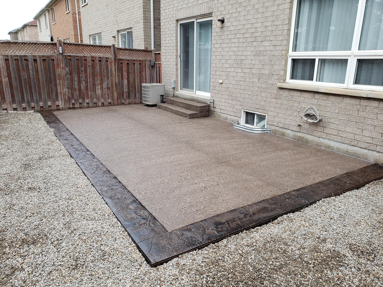 New patio. Exposed aggregate with stamped concrete border