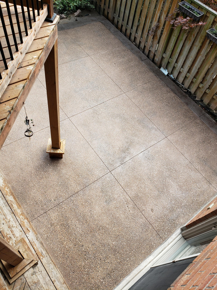 New backyard patio. Exposed aggregate with stamped concrete border