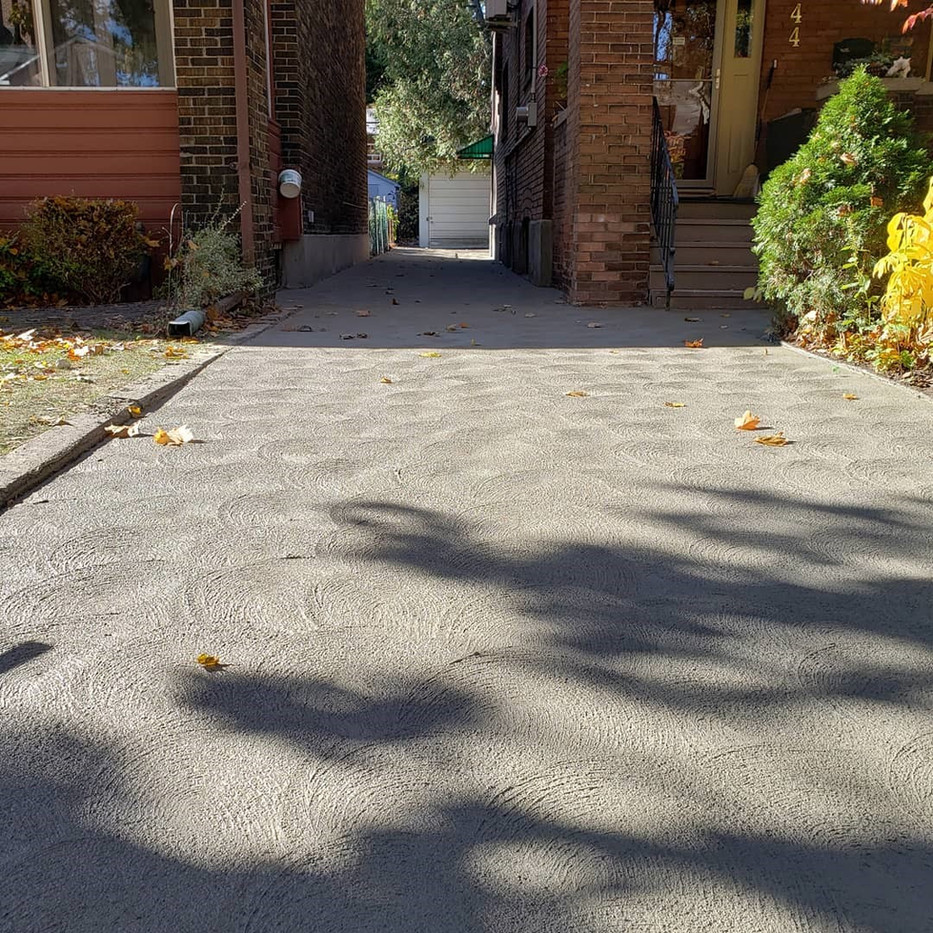 Spin finish on new driveway completed