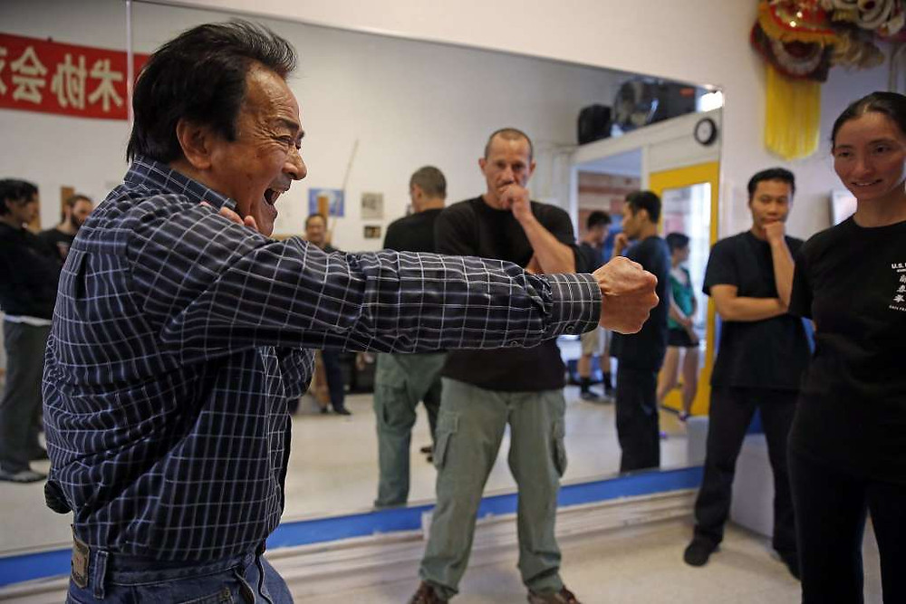 FILE-- Grandmaster Chris Chan, friend of Bruce Lee, teaching class at U.S. Wing Chun in San Francisco on Wednesday, Aug. 5, 2015. San Francisco native Bruce Lee will be honored this afternoon with a plaque at the Chinatown hospital where he was born, presented by the makers of a new movie about him