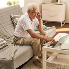 senior-man-working-from-home-ABPFZ5R.jpg
