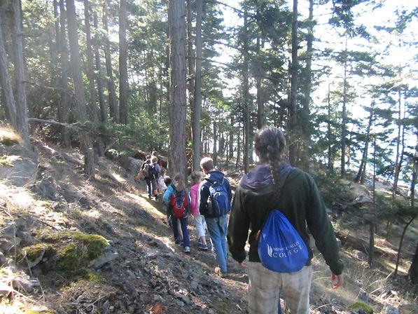 Students/staff walking on trail